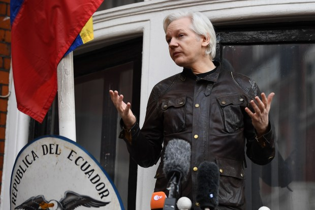 Wikileaks founder Julian Assange speaks on the balcony of the Embassy of Ecuador in London on May 19, 2017. (Justin Tallis, AFP Getty)