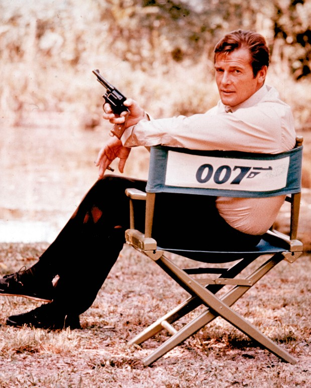 British actor Roger Moore, playing the title role of secret service agent 007, James Bond, is shown on location in England in 1972. Moore, played Bond in seven films, more than any other actor. Roger Moore's family said Tuesday May 23, 2017 that the former James Bond star has died after a short battle with cancer. (AP Photo, File)