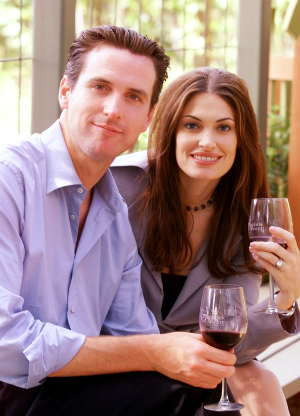 Gavin Newsom, left, and his wife, Kimberly Guilfoyle Newsom, pose for a picture at the PlumpJack winery in Oakville, Calif., Friday June 7, 2002. San Francisco Mayor Gavin Newsom and his wife, Court TV legal analyst Kimberly Guilfoyle Newsom, are filing for divorce after three years of marriage. In a joint statement issued Wednesday by the mayor's office, the Newsoms cited the strain posed by their high-profile, bicoastal careers as the reason for the split. (AP Photo/Eric Risberg)
