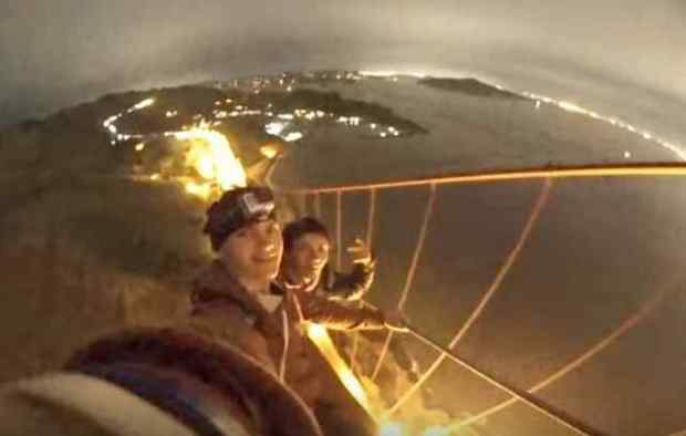 Two youths climb the north tower of the Golden Gate Bridge. (Caters Clips via youtube.com)