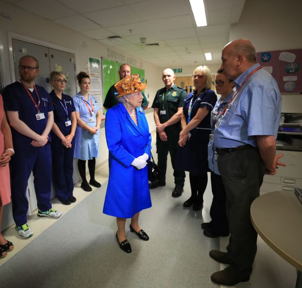 MANCHESTER, ENGLAND - MAY 25: Queen Elizabeth II  meets medical staff during a visit to the Royal Manchester Children's Hospital on May 25, 2017 in Manchester, England.  Queen Elizabeth visited the hospital to meet victims of the Manchester Arena terror attack and to thank members of staff who treated them. (Photo by Peter Byrne/WPA Pool/Getty Images)