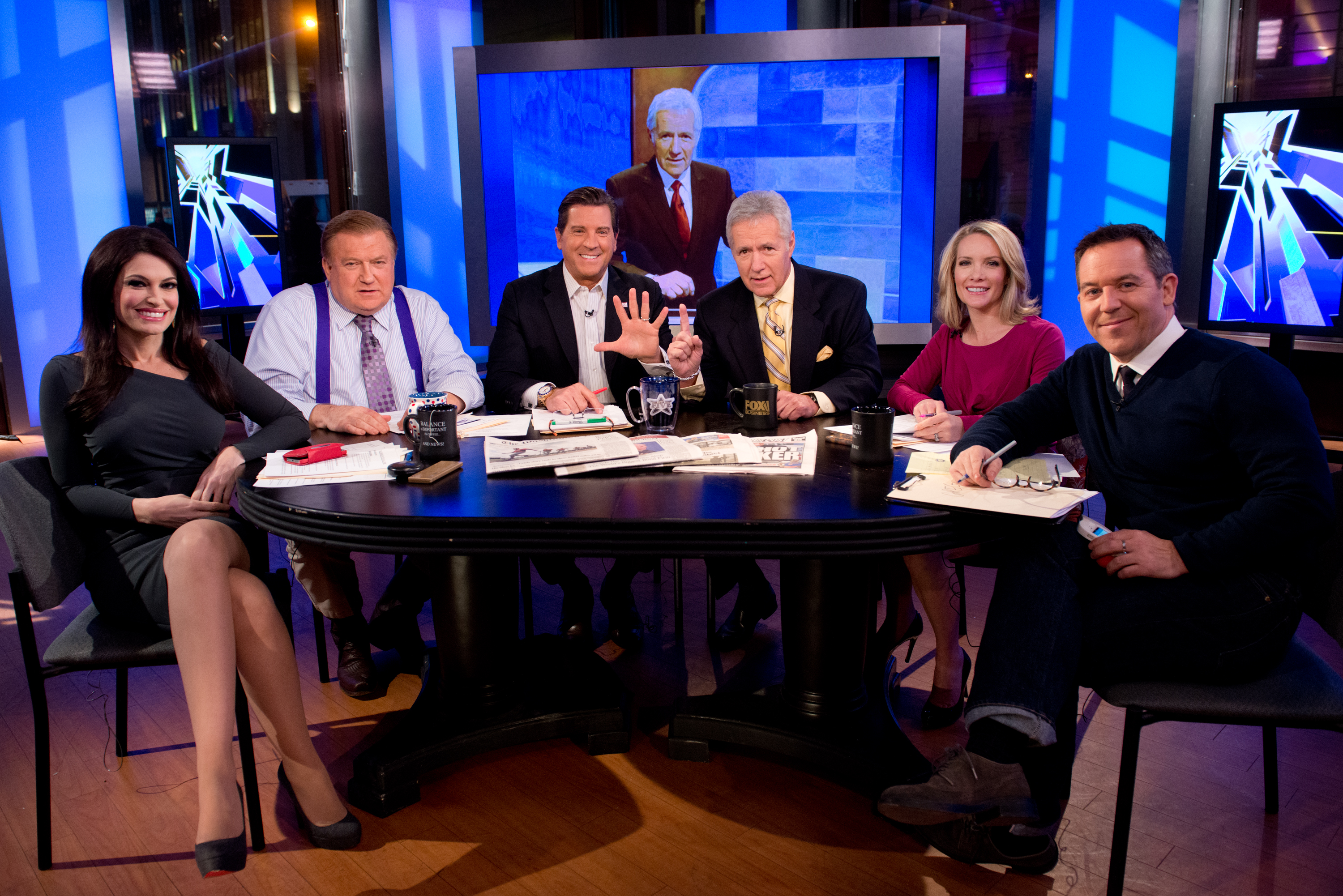 """TV personality Alex Trebek, third from right, and the hosts of 'The Five,' left to right, Kimberly Guilfoyle, Bob Beckel, Eric Bolling, Dana Perino and Greg Gutfeld attend FOX News' """"The Five"""" at FOX Studios on February 26, 2014 in New York City.  (Photo by Noam Galai/Getty Images)"""