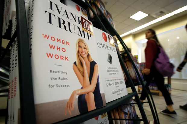 "A woman walks past a shelf displaying Ivanka Trump's book ""Women Who Work: Rewriting the Rules for Success"" at a Barnes and Nobel bookstore in New York on May 2, 2017. Ivanka Trump revived ethics concerns by publishing a self-help book for working women, albeit peppered with advice likely to jar with those outside the moneyed elite. ""Women Who Work: Rewriting the Rules for Success"" was released simultaneously in hardback, ebook, 497-minute audio download and CD. / AFP PHOTO / Jewel SAMAD (Photo credit should read JEWEL SAMAD/AFP/Getty Images)"