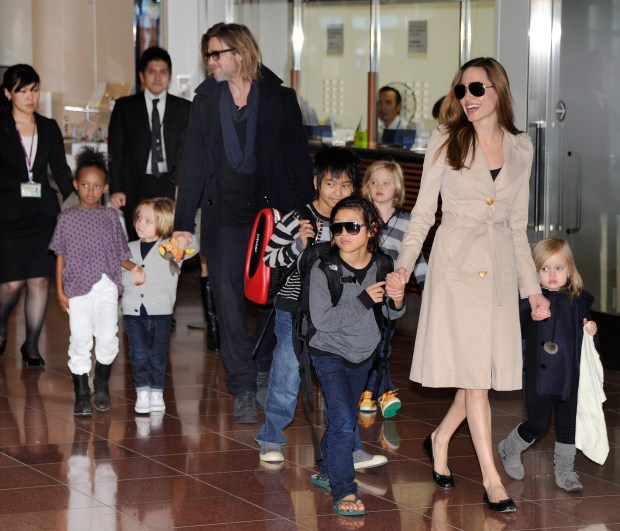 Accompanied by their six children, US movie stars Brad Pitt and Angellina Jolie appear before photographers upon their arrival at Haneda Airport in Tokyo on November 8, 2011. Brad Pitt is here for the Japan premiere of his last film 'Moneyball'. AFP PHOTO/Toru YAMANAKA (Photo credit should read TORU YAMANAKA/AFP/Getty Images)