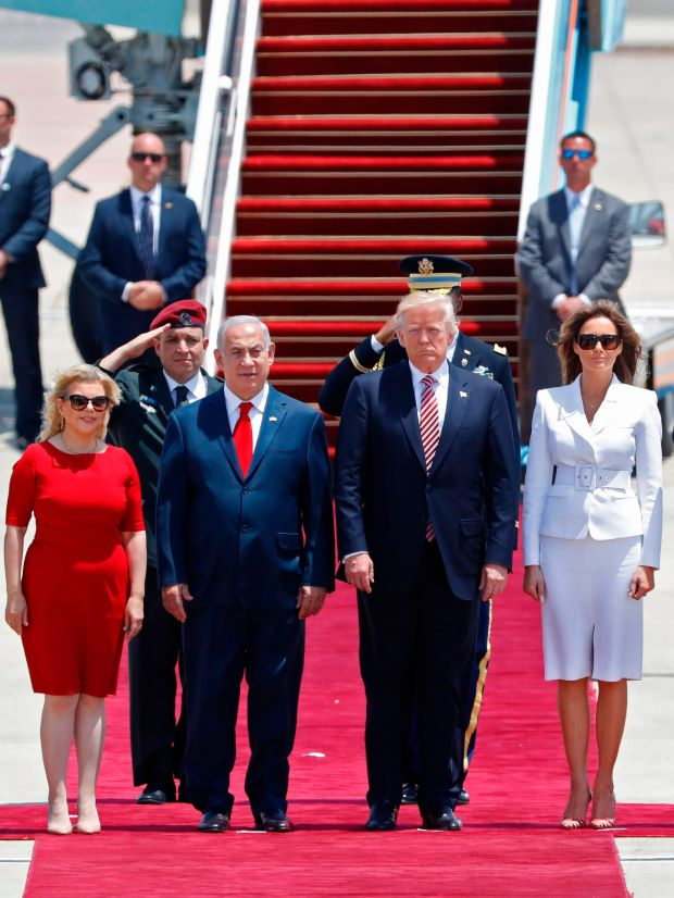 US President Donald Trump (C), First Lady Melania Trump, Israeli Prime Minister Benjamin Netanyahu (2-L) and his wife Sara listen to the national anthem upon Trump's arrival at Ben Gurion International Airport in Tel Aviv on May 22, 2017, as part of his first trip overseas. / AFP PHOTO / Jack GUEZ (Photo credit should read JACK GUEZ/AFP/Getty Images)
