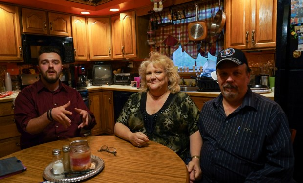 Daniel J. Moore, from left, Lisa Moore and Daniel E. Moore pose for a picture at their kitchen table in Newton Falls, Ohio, Monday, May 1, 2017. Facebook founder Mark Zuckerberg dined with the Moore family on Friday as part of a mission to visit all 50 states. (AP photo/Dake Kang)