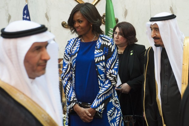 Saudi new King Salman (R), and US First Lady Michelle Obama (C) hold a receiving line for delegation members at the Erga Palace in the capital Riyadh on January 27, 2015. US President Barack Obama is in Saudi Arabia to shore up ties with new King Salman and offer condolences after the death of his predecessor Abdullah. AFP PHOTO / SAUL LOEB (Photo credit should read SAUL LOEB/AFP/Getty Images)