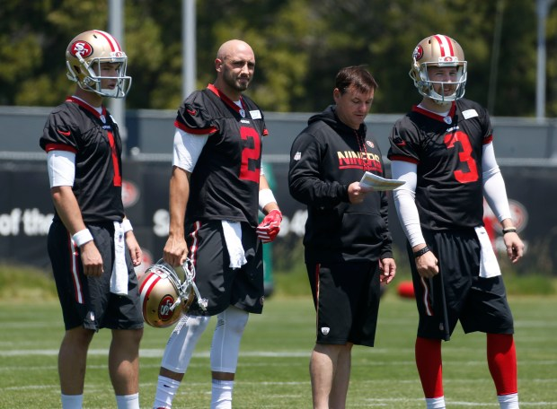 From left, quarterback Nick Mullens (1), quarterback Brian Hoyer (2), quarterbacks coach, Rich Scangarello, and quarterback C.J. Beathard (3) participate in the San Francisco 49ers first team practice at Levi's Stadium in Santa Clara, Calif., Tuesday, May 23, 2017. (Patrick Tehan/Bay Area News Group)