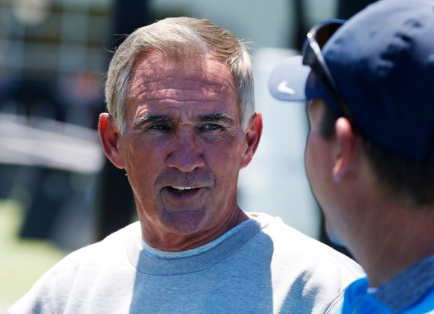Former NFL coach Mike Shanahan talks with a reporter as he watches his son, Niners head coach Kyle Shanahan run the San Francisco 49ers organized team activity at Levi's Stadium in Santa Clara, Calif., Wednesday, May 31, 2017. (Patrick Tehan/Bay Area News Group)