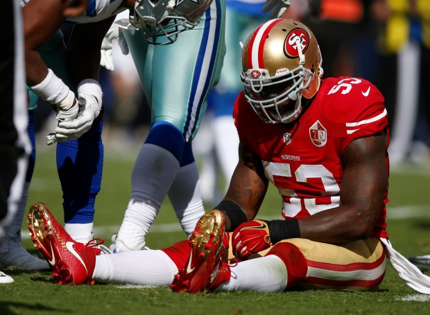 San Francisco 49ers' NaVorro Bowman (53) sits on the field after getting injured during their game against the Dallas Cowboys in the third quarter of their NFL game at Levi's Stadium in Santa Clara, Calif., on Sunday, Oct. 2, 2016. (Nhat V. Meyer/Bay Area News Group)