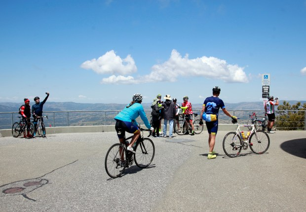 Cyclists gather on the summit of Mount Hamilton, east of San Jose, Calif., Monday, May 15, 2017, in anticipation of Stage 2 of the Amgen Tour of California bicycle race. (Karl Mondon/Bay Area News Group)