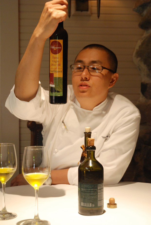 "Chef Corey Lee scrutinizes olive oil from Spain during a tasting at the French Laundry in Yountville, Calif. Since its opening in 1994, critics have called the French Laundry ""visionary"" and ""the best restaurant in America,"" and supplying products for its dining room is the holy grail for a small producer. Illustrates FRENCHLAUNDRY (category d), by Jane Black (c) 2008, The Washington Post. Moved Monday, Oct. 20, 2008. (MUST CREDIT: Photo for The Washington Post by Kate Black.)"