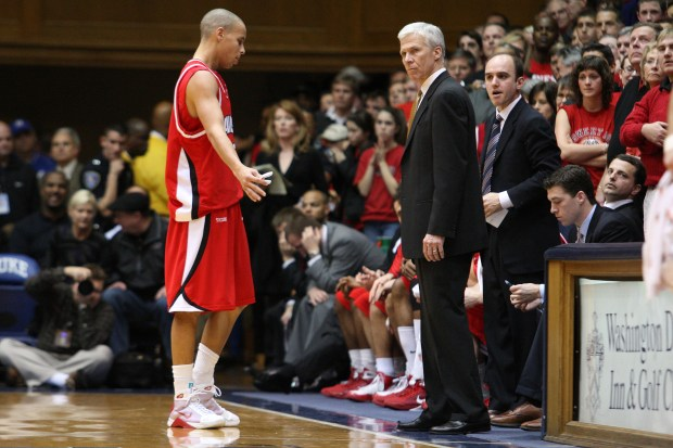 Stephen Curry chats with Davidson coach Bob McKillop during a game at Duke in January of 2009. Curry scored 29 points in the loss. (Courtesy Tim Cowie, DavidsonPhotos.com)