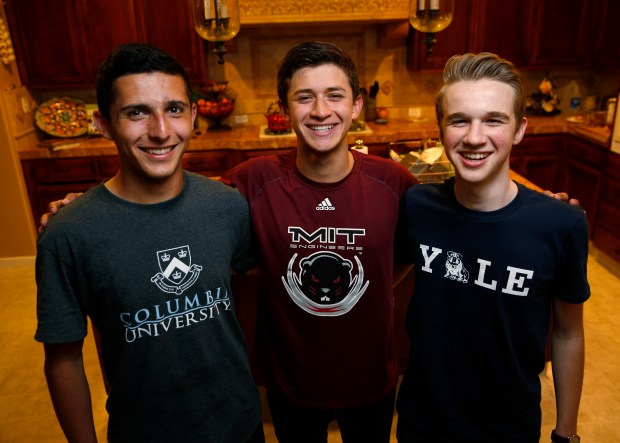From left to right, friends Eric Heiser, 18, a senior at Gilroy High School, Alejandro Diaz, 17, a senior at Christopher High School, and Jacob Yoder-Schrock, 18, a senior at Christopher High school, senior pose for a picture at the Diaz home in Gilroy, Calif., on Wednesday, May 10, 2017. Heiser will be attending Columbia University, Yoder-Schrock will be attending Yale and Diaz will be attending M.I.T. (Nhat V. Meyer/Bay Area News Group)