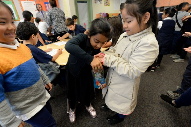 Balpreet Kaurnijjar, 8, center, applies soap to the hands of Lien Hyunh, 8, during a hand washing lesson at Anne Darling Elementary School in San Jose, Calif., on Wednesday, May 17, 2017. This exercise and lesson is being done in the wake of the outbreak of stomach flu in several schools within the San Jose Unified School District. (Dan Honda/Bay Area News Group)