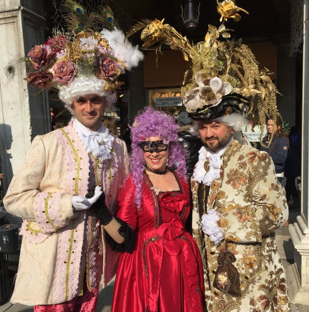 COURTESY OF LAUREN FAHRERITALY: Walnut Creek resident Lauren Fahrer -- in red -- and a couple of German partygoers celebrated Carnival in St. Mark's Square in Venice in February.