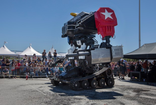 A Megabot entertains the crowd during the Maker Faire at the San Mateo Event Center in San Mateo, Calif., Saturday, May 20, 2017. This weekend's Maker Faire is a showcase of invention, earsplitting pyrotechnics, robots, crafts and large-scale art. (Patrick Tehan/Bay Area News Group)