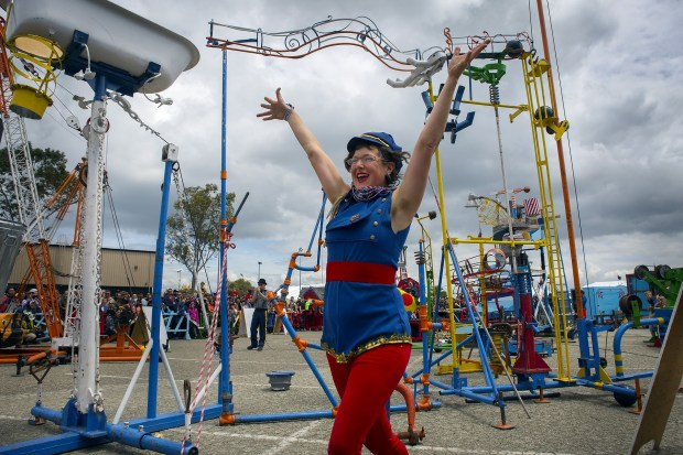 Genevieve Griesau fires up the crowd before the 'The Life Size Game of Mousetrap' is played during the annual Maker Faire at the San Mateo County Event Center in San Mateo, Calif., Saturday, May 21, 2016. Maker Faire is an event in which inventors and really smart people show off their creations and hacks. It's part science fair, part county fair and a gathering of the clans for inventors, tinkerers, hobbyists, scientists, engineers, artists, students, and commercial exhibitors. (Patrick Tehan/Bay Area News Group)