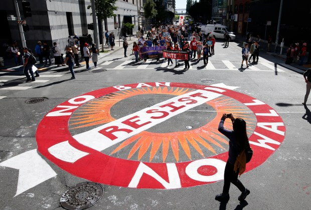 May Day protesters march toward a painted intersection at Sansome and Washington Streets in front of the Immigration and Customs Enforcement (ICE) office, Monday, May 1, 2017, in San Francisco, Calif. (Karl Mondon/Bay Area News Group)