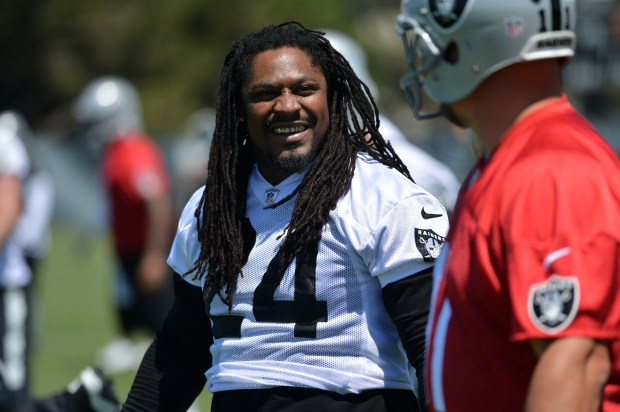 Marshawn Lynch (24) chats with teammates during practice for the Oakland Raiders in Alameda, Calif. on Tuesday, May 23, 2017. (Kristopher Skinner/Bay Area News Group)