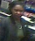 San Mateo police are asking for the public's help in identifying this woman, who is suspected of stealing alcoholic beverage from a Safeway and dragging an officer who tried to intervene. (Courtesy of the San Mateo Police Department)