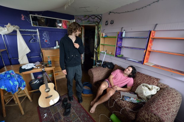 Zach Gamlieli, Berkeley Student Cooperative President, left, talks with Tom Edmondson, a former co-op resident, in a double room at Casa Zimbabwe in Berkeley, Calif. on Wednesday, May 24, 2017. Casa Zimbabwe is one of the 20 affordable housing communities operated by the Berkeley Student Cooperative. (Kristopher Skinner/Bay Area News Group)