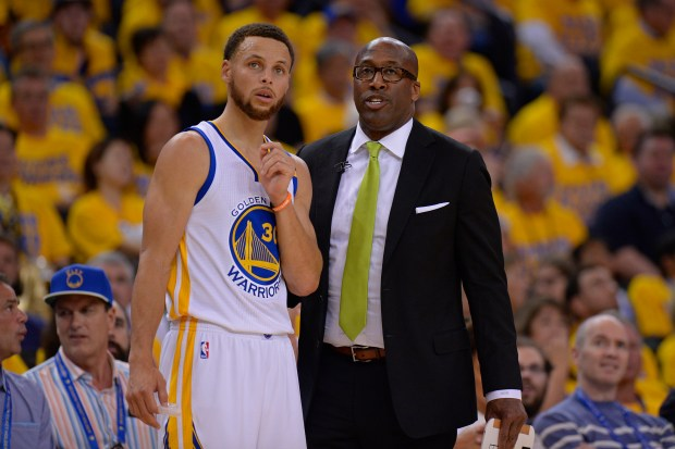 Golden State Warriors' Stephen Curry (30) chats with Golden State Warriors interim head coach Mike Brown while playing the Utah Jazz during the third quarter of Game 1 of their NBA second-round playoff series at Oracle Arena in Oakland, Calif. on Tuesday, May 2, 2017. The Golden State Warriors defeated the Utah Jazz 106-94. (Jose Carlos Fajardo/Bay Area News Group)