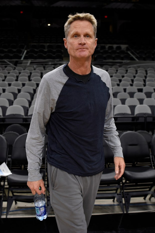 Golden State Warriors head coach Steve Kerr walks on the court during a practice session before Game 4 of the NBA Western Conference Finals at AT&T Center in San Antonio, Texas, on Sunday, May 21, 2017. (Jose Carlos Fajardo/Bay Area News Group)