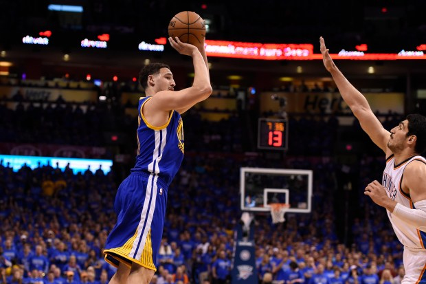 Golden State Warriors' Klay Thompson (11) shoots over Oklahoma City Thunder's Enes Kanter (11) in the second quarter of Game 6 of the NBA Western Conference finals at Chesapeake Energy Arena in Oklahoma City, Okla., on Saturday, May 28, 2016. (Jose Carlos Fajardo/Bay Area News Group)