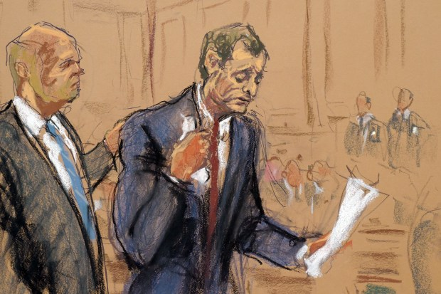 In this courtroom artist's sketch, Anthony Weiner, right, accompanied by his attorney Arlo Devlin-Brown, reads a statement during a hearing, Friday, May 14, 2017 in New York Federal court. Weiner pleaded guilty to transmitting sexual material to a minor. (Jane Rosenberg via AP)