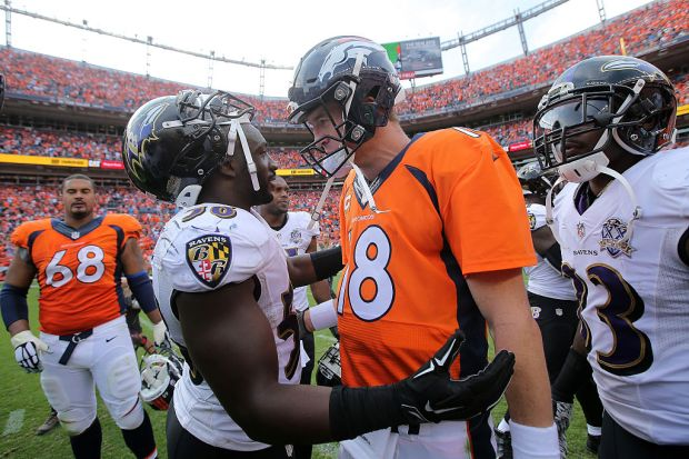 DENVER, CO - SEPTEMBER 13: Elvis Dumervil #58 of the Baltimore Ravens and Peyton Manning #18 of the Denver Broncos meet at midfield after their game at Sports Authority Field at Mile High on September 13, 2015 in Denver, Colorado. The Broncos defeated the Ravens 19-13. (Photo by Doug Pensinger/Getty Images)