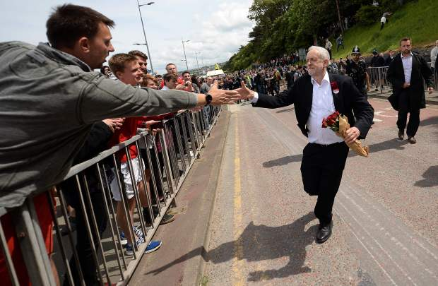 Britain's main opposition Labour Party leader Jeremy Corbyn greets supporters as he leaves after attending a campaign visit in Colwyn Bay, north Wales on June 7, 2017. (Oli Scarff, AFP Getty)