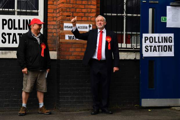 Britain's main opposition Labour Party leader Jeremy Corbyn arrives at a polling station to cast his vote in north London on June 8, 2017. (Justin Tallis, AFP Getty)