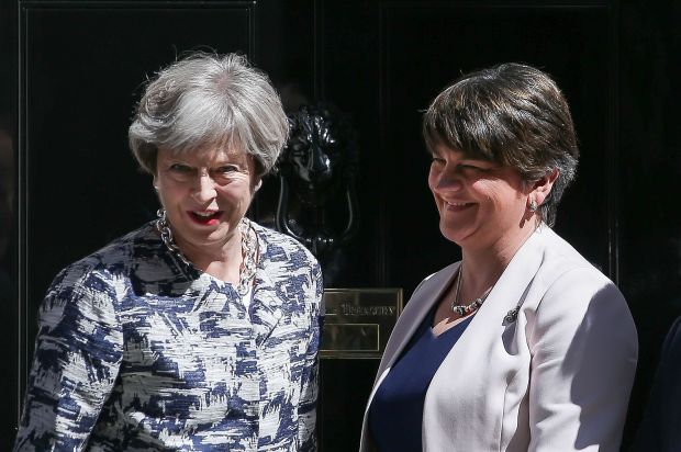 Britain's Prime Minister Theresa May, left,  with Democratic Unionist Party leader Arlene Foster at 10 Downing Street in London on June 26, 2017. (Daniel Leal-Olivas, AFP Getty)