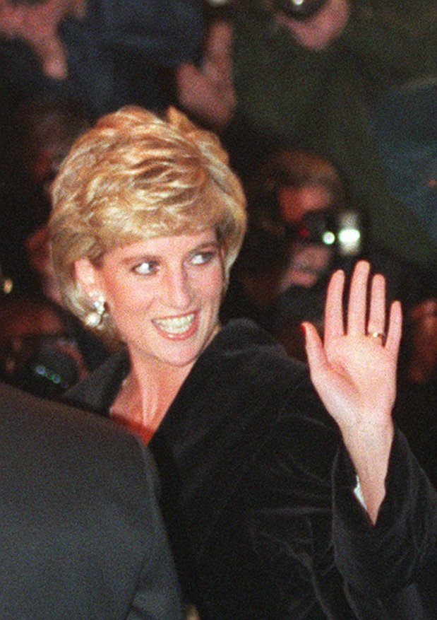 Britain's Princess of Wales, at her first public engagement since agreeing to end her 15-year marriage to Prince Charles, still wearing her wedding ring, waves to wellwishers as she arrives at the Harrods department store in London, Thursday Mar.7, 1996, to attend a Gala dinner in honor of heart transplant surgeon Magdi Yacoub. (AP Photo/Max Nash)