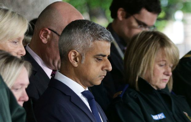 Mayor of London Sadiq Khan, joins London Ambulance workers in observing a minute's silence in honour of the London Bridge terror attack victims, Tuesday June 6, 2017. (Yui Mok/PA via AP)