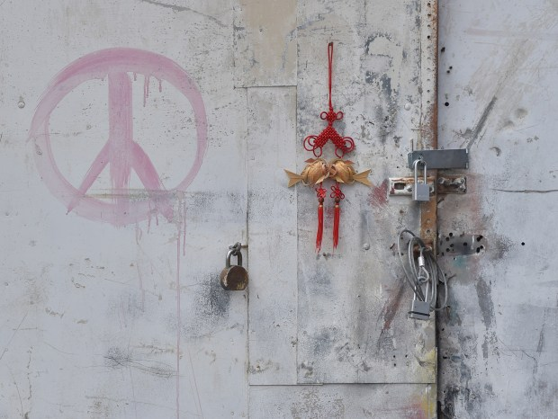 Los Angeles building where Max Harris, 27, was arrested Monday June 5, 2017. Harris was the person who planned the Ghost Ship party in Oakland on December 2014 where 36 people died in a fire. Peace sign adorns door at Harris living space on Slauson Ave.Photo by Robert Casillas, Daily Breeze/SCNG