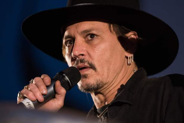 Actor Johnny Depp introduces his film, The Libertine, to the audience at 'Cineramageddon', the outdoor cinema venue, at the Glastonbury Festival of Music and Performing Arts on Worthy Farm near the village of Pilton in Somerset, South West England, on June 22, 2017. / AFP PHOTO / Oli SCARFFOLI SCARFF/AFP/Getty Images
