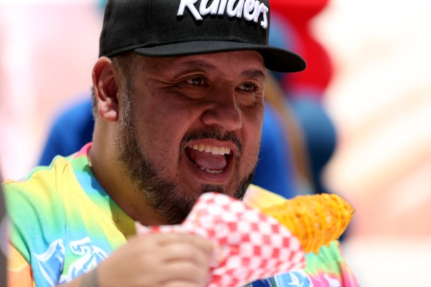 Hot 105.7 Bay Area radio personality and judge Chuy Gomez tries the Doritos corn on the cob, fresh, roasted corn on the cob rolled in a crunchy layer of crushed Doritos and topped with warm cheese created by California Corn Company during the 2017 Snackdown Fryday competition at the Alameda County Fair in Pleasanton, Calif., on Friday, June 23, 2017. The annual friendly competition features the outrageous new creations offered up by fair food vendors. (Anda Chu/Bay Area News Group)