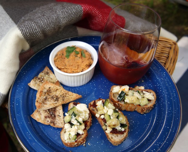 A Negroni cocktail with Zucchini and Harissa Bruschetta, and Red Lentil Hummus are served at the Casini Ranch Family Campground in Duncans Mills, Calif., on Friday, April 18, 2014. Small teardrop trailers, such as those manufactured by Vacations in a Can near Petaluma, have become increasingly popular the past few years. They first appeared in the 1930s, and slowly faded from use in the 1960s. The trailer sleeps two adults and features a galley in the rear. (Jane Tyska/Bay Area News Group)
