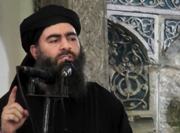 This image made from a 2014 video purports to show the leader of the Islamic State group, Abu Bakr al-Baghdadi. (AP Photo/Militant video, File)