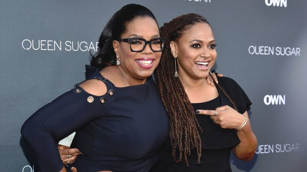 Oprah Winfrey, left, and filmmaker Ava DuVernay at a theater on the WarnerBros. studio lot last summer in Burbank. (Mike Windle/Getty Images)