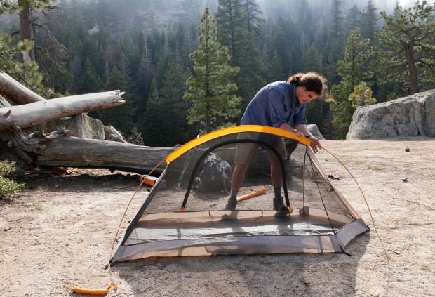Tom Wynne, 20, of Philadelphia, pitches his tent above Yosemite Falls on Friday, May 26, 2017, at Yosemite National Park, Calif. Wynne, on a six week trip across the country, was able to get a wilderness camping permit without a reservation. (Jim Gensheimer/Bay Area News Group)