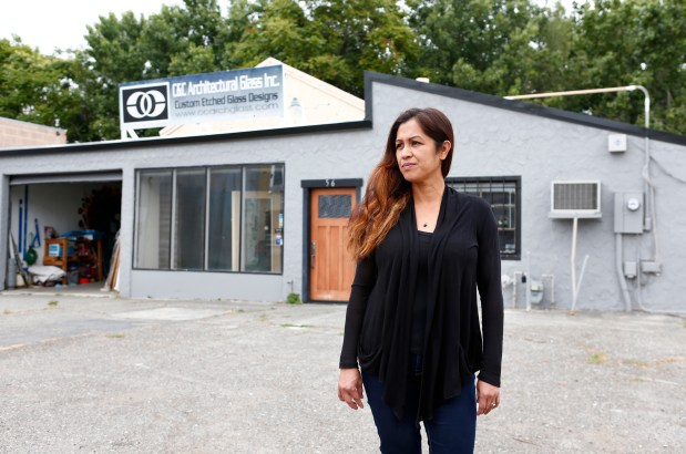 Eva Vela is photographed in front of her business, C&C Architectural Glass, in San Jose, California, on Thursday, June 8, 2017. Eva and her husband, Charles Vela, have run the business at this location for the past ten years. The shop is near the Diridon Station and the SAP Center where Google is planning a 245-acre project. (Gary Reyes/ Bay Area News Group)