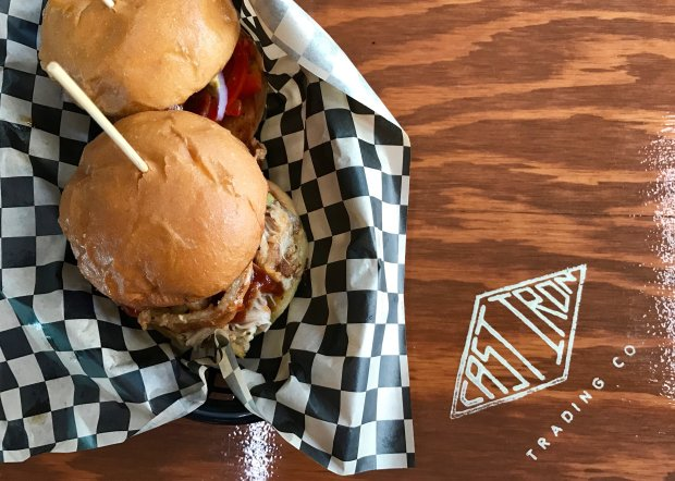 A pair of sliders -- one filled with Lockeford's spicy sausages, the otherwith barbecue chicken, front -- are perfect examples of the pub grub available at Stockton's delicious new Cast Iron Trading Co. (Jackie Burrell/Bay Area News Group)