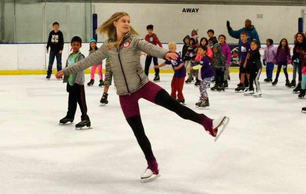 Local figure skating great Polina Edmunds, 2014 U.S. Olympic Team member, skates with kids at Solar4America Ice as she helped celebrate Olympic Day in San Jose, California, Friday. June 23, 2017. Edmunds and her coaches hosted approximately 100 kids from the Southwest and East Valley YMCA's for an afternoon of free skating. The event was held at Solar4America Ice and was followed by a Q and A session between the kids and Edmunds. (Patrick Tehan/Bay Area News Group)