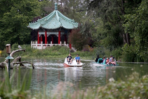 Visitors paddle boat on Stow Lake past the Chinese pavilion inside Golden Gate Park in San Francisco, Calif., on Tuesday, June 6, 2017. The pavilion was presented to San Francisco by its sister city Taipei in 1976. (Anda Chu/Bay Area News Group)