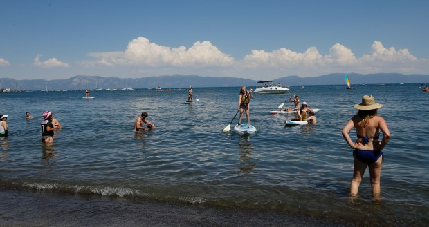 Beach-goers enjoy the water at the popular family beach Commons Beach on Lake Tahoe in Tahoe City, California on Sunday, June 25, 2017. The beach used to extend out to where the white boat in the background is visible in the picture according to the locals/kayak rental personal. (Josie Lepe/Bay Area News Group)