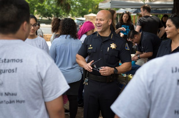 Police Chief Eddie Garcia talks with residents as San Jose Police hosted a community event in the city's crime & gang-riddled Hoffman Via Monte neighborhood in San Jose, Calif., Saturday, June 3, 2017. The event is the culmination of a pilot program that the PD's crime prevention unit has led in this troubled neighborhood for the past year. (Patrick Tehan/Bay Area News Group)
