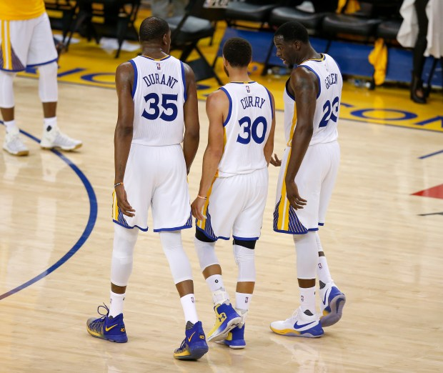 Golden State Warriors' Kevin Durant (35), Golden State Warriors' Stephen Curry (30) and Golden State Warriors' Draymond Green (23) head to the locker room at the end of the second quarter of Game 1 of their NBA second-round playoff series against the Utah Jazz at Oracle Arena in Oakland, Calif., on Tuesday, May 2, 2017. (Nhat V. Meyer/Bay Area News Group Archives)